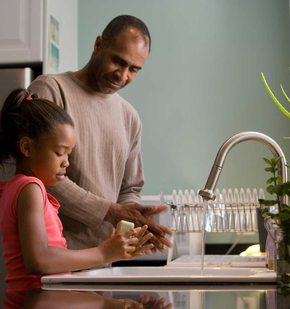 Dad and daughter washing hands