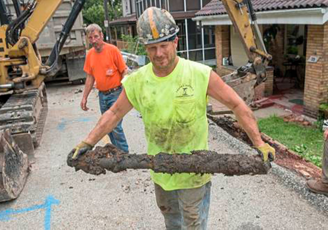 Workers pull out old lead pipe in Pittsburgh